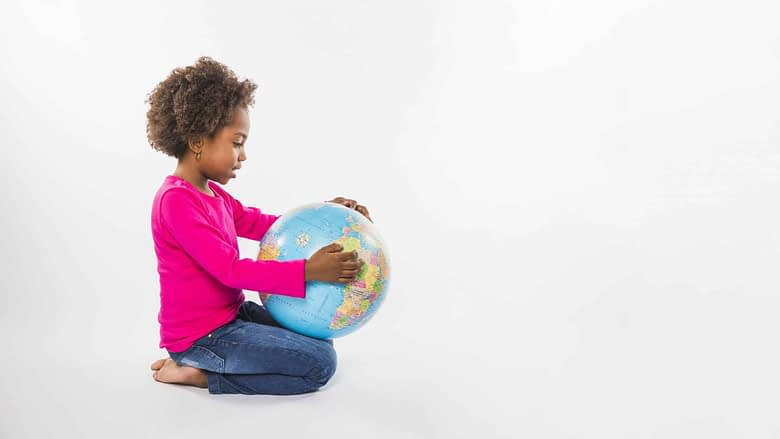 Little Black Girl with Map Travel